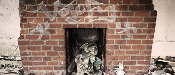 The teddy I saw 2 years ago, found today wedged in fireplace with a toy snowman for company...